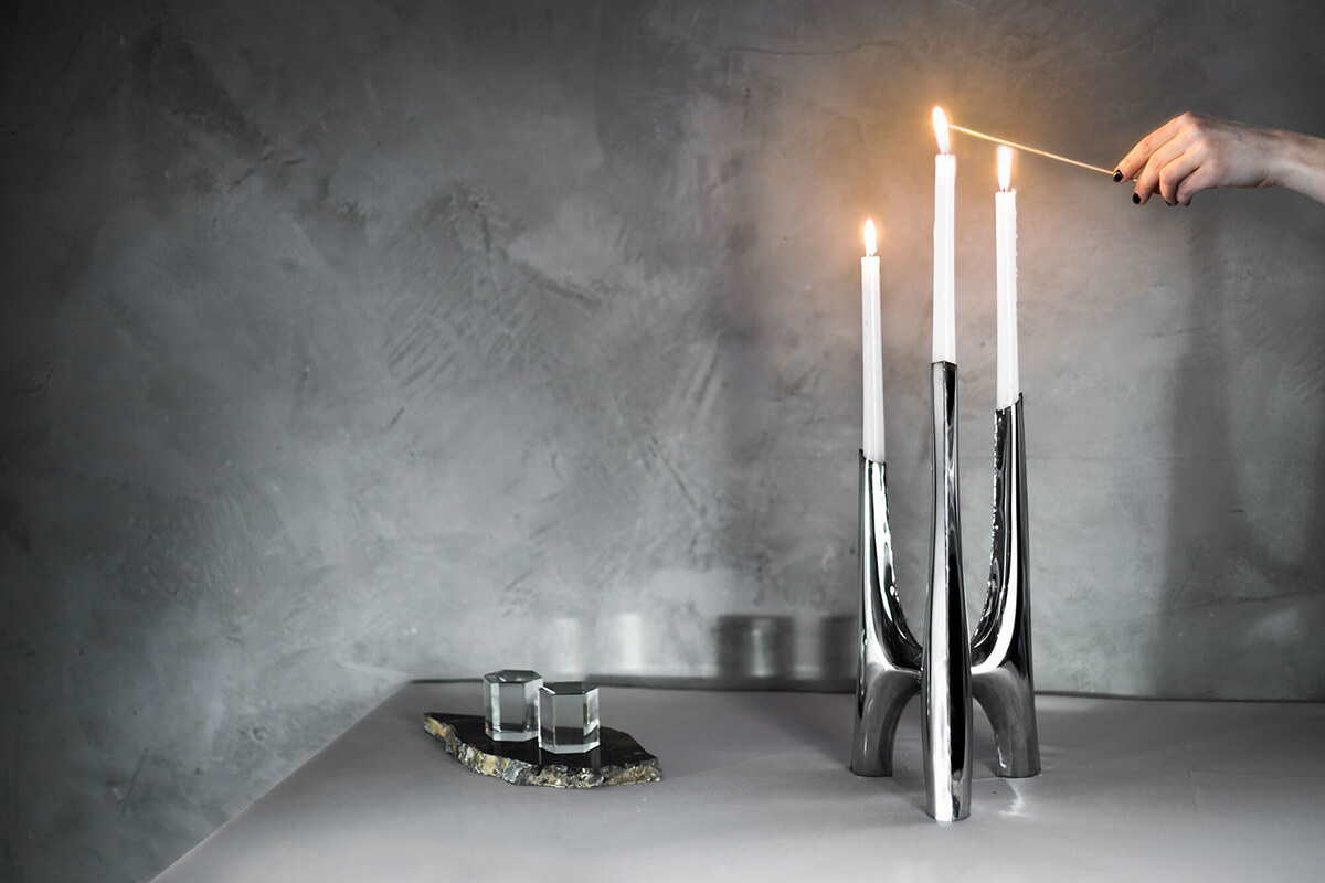 triglav candelabrum by zieta studio with candles burning